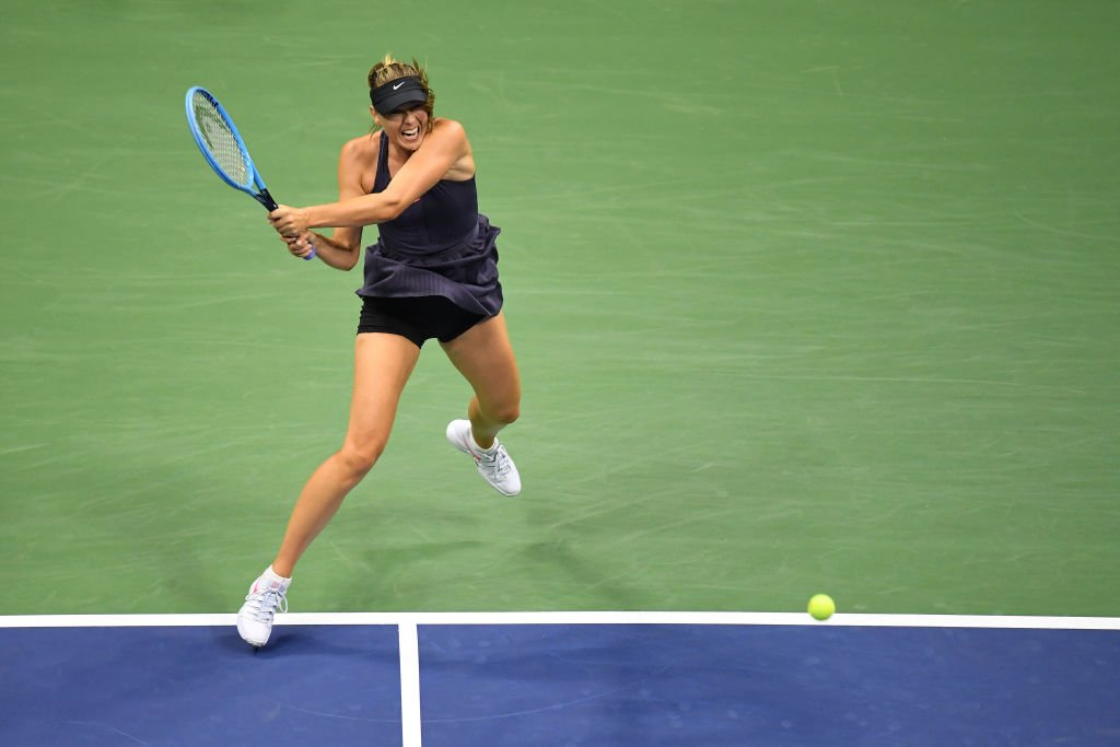 Maria Sharapova playing against Serena Williams in the first round of the US Open on Aug. 26, 2019 in New York City | Photo: Getty Images