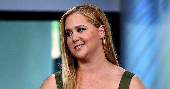 Amy Schumer's 3-Month-Old Son Gene Chews on Her Sister Kim Caramele's Hand in a New Video