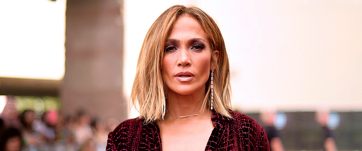 Jennifer Lopez Stuns in $3,750 Maroon Leather Dress Covering Her Head with a Matching Beret
