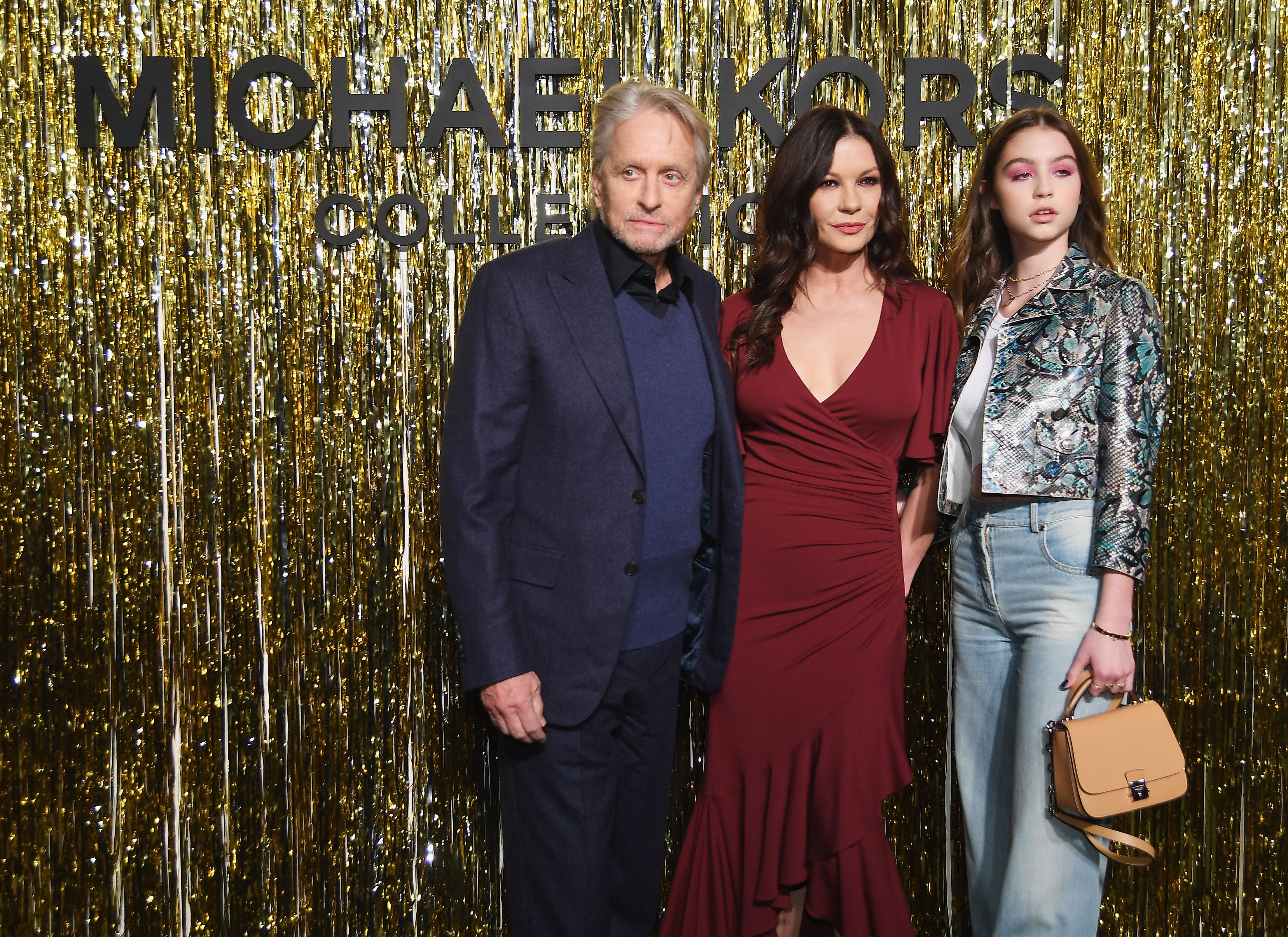 Michael Douglas, and his wife Catherine Zeta-Jones, and their daughter Carys Zeta Douglas attend the Michael Kors Collection Fall 2019 Runway Show at Cipriani Wall Street on February 13, 2019 in New York City | Photo: Getty Images