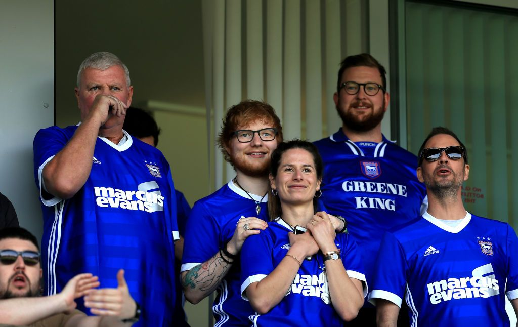 Ed Sheeran and Cherry Seaborn look on during the Sky Bet Championship match between Ipswich Town and Aston Villa at Portman Road on April 21, 2018 in Ipswich, England. | Source: Getty Images