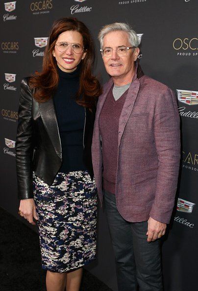 Desiree Gruber (L) and Kyle MacLachlan attend the Cadillac Oscar Week Celebration at Chateau Marmont on February 21, 2019, in Los Angeles, California. | Source: Getty Images.