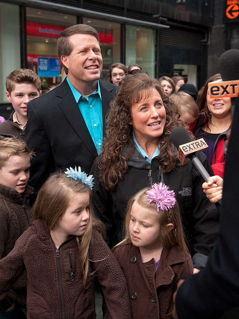 Image Credits: Getty Images/ Jim Bob Duggar (L), wife Michelle Duggar, and their children