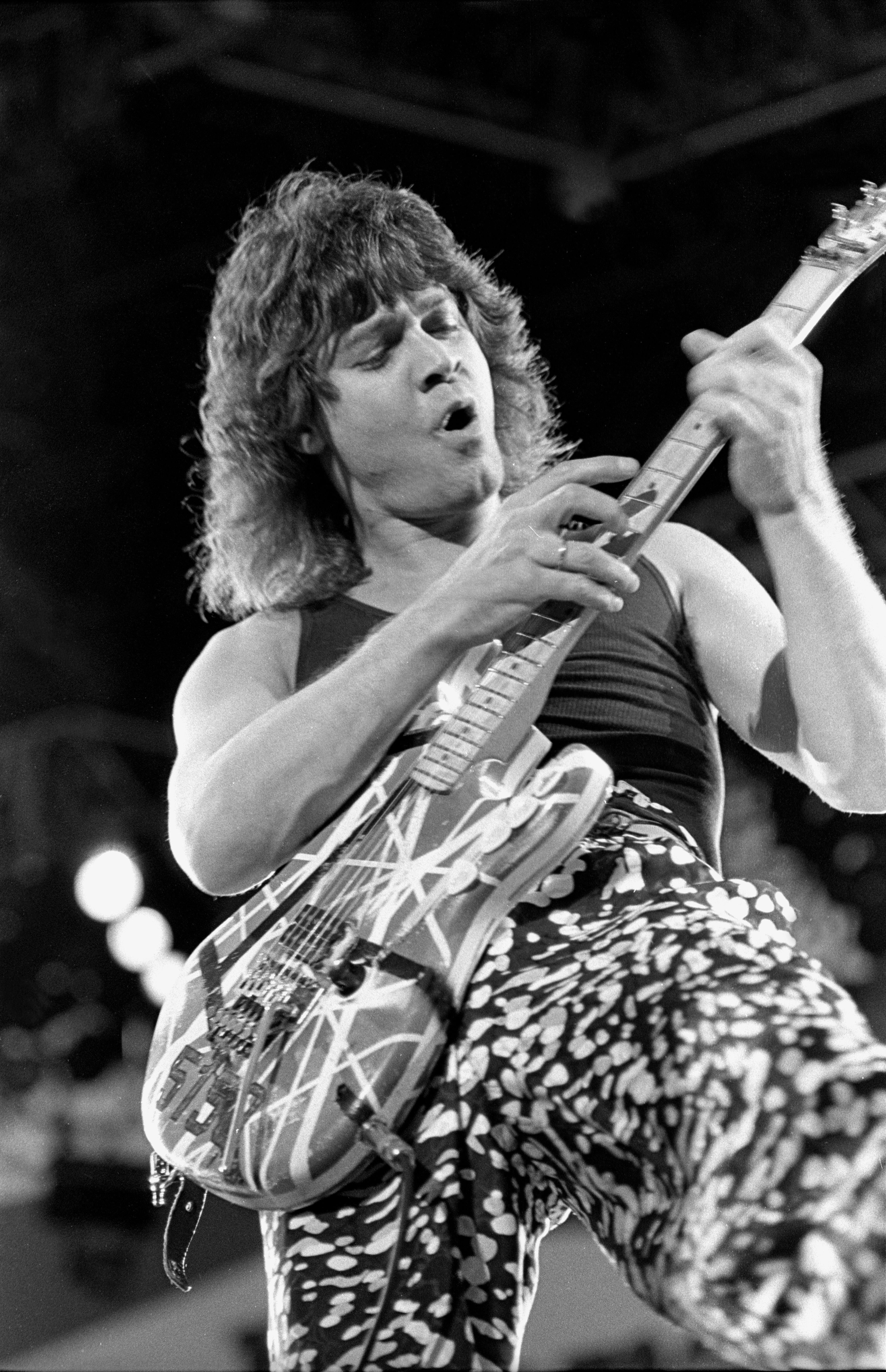 """Eddie Van Halen performing on stage during a """"live"""" concert appearance with Van Halen in 1988   Source: Getty Images"""