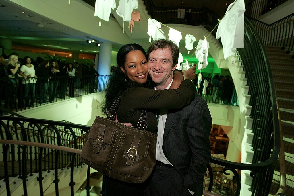 Actress Garcelle Beauvais (L) and her husband Mike Nilon attend the LACOSTE and Barneys New York unveiling of celebrity customized polos, held at Barney's New York on October 20, 2005 | Photo: Getty Images