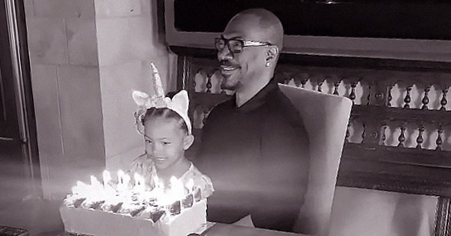 Eddie Murphy & Youngest Daughter Izzy Blow Out Candles on His Birthday Cake as He Turns 60