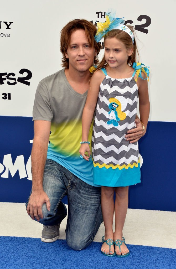 "Larry Birkhead and daughter Dannielynn attend the premiere of ""Smurfs 2"" in Westwood, California on July 28, 2013 