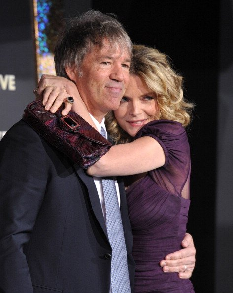 """David E. Kelley and Michelle Pfeiffer arrive to the Premiere Of Warner Bros. Pictures' """"New Year's Eve"""" on December 5, 2011, in Hollywood, California. 