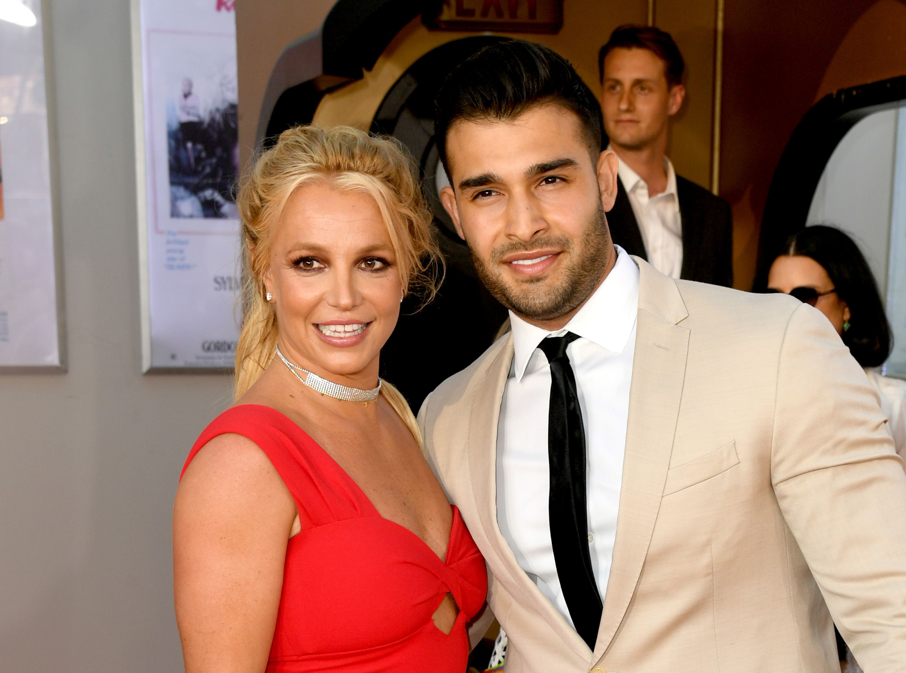 """Britney Spears (L) and Sam Asghari at the premiere of Sony Pictures' """"One Upon A Time...In Hollywood"""" at the Chinese Theatre on July 22, 2019   Photo: Getty Images"""