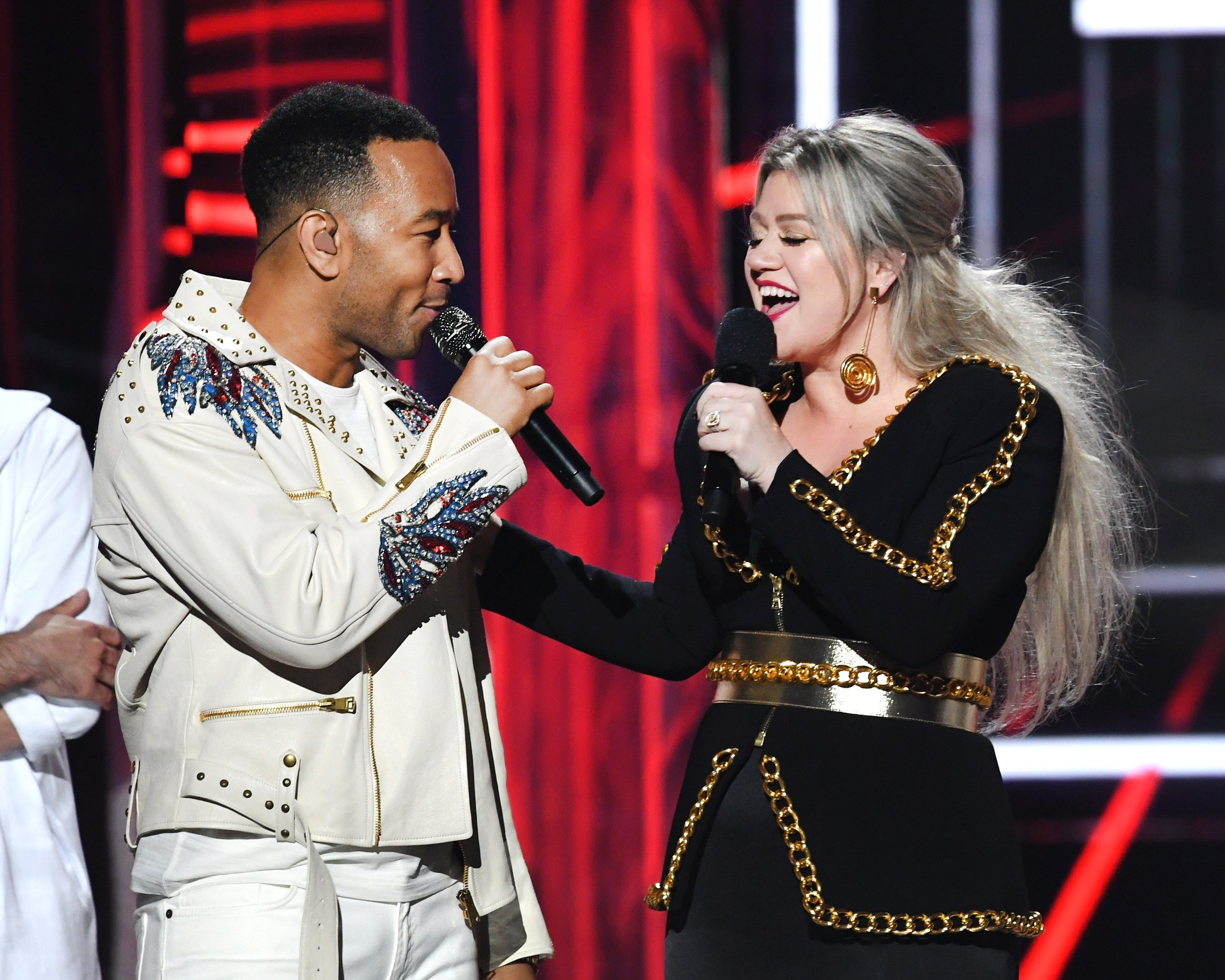 John Legend and Kelly Clarkson onstage at the 2018 Billboard Music Awards in Las Vegas, Nevada on May 20, 2018 | Photo: Getty Images