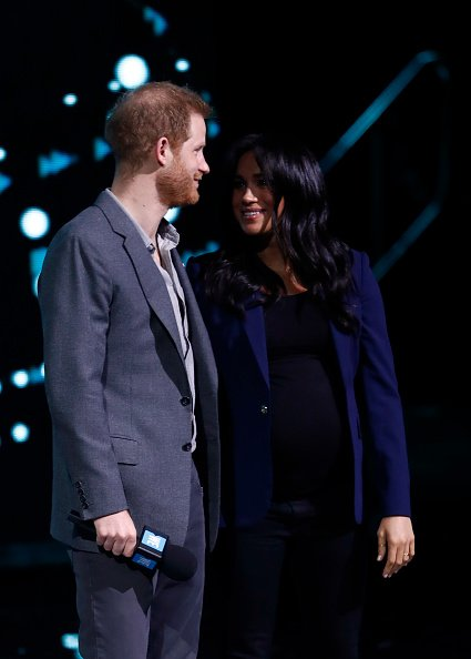 Prince Harry and Meghan speak onstage at The SSE Arena on March 06, 2019, in London, England. | Source: Getty Images.