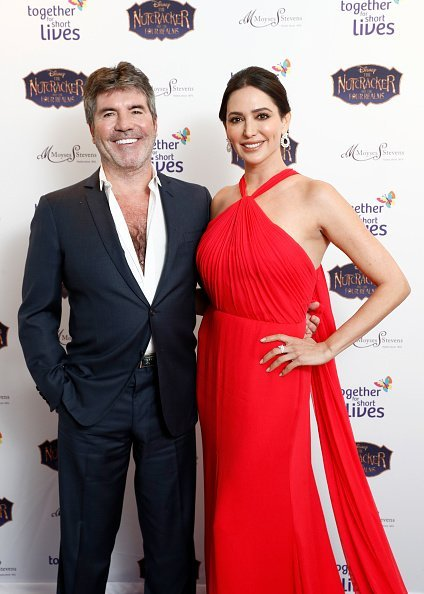 Simon Cowell and Lauren Silverman attend the Together For Short Livessss 'Nutcracker Ball' at One Marylebone on November 20, 2018, in London, England. | Source: Getty Images.