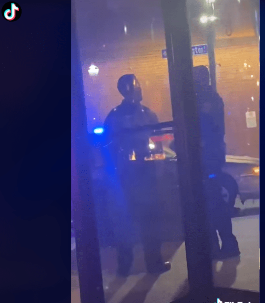 A screenshot of a video showing the moment a man was arrested by police officers | Photo: Tiktok/emmykaityoh