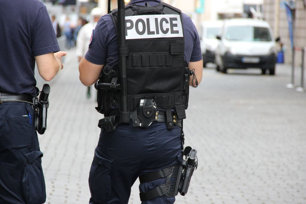 Policeman standing in a street. | Photo: Shutterstock
