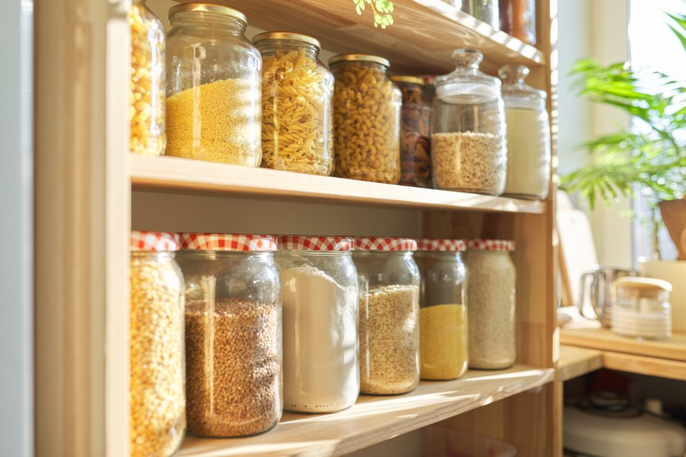 A photo of pantry with grain products in storage jars. | Photo: Shutterstock