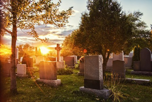 Sunrise over a cemetery. | Source: Shutterstock.