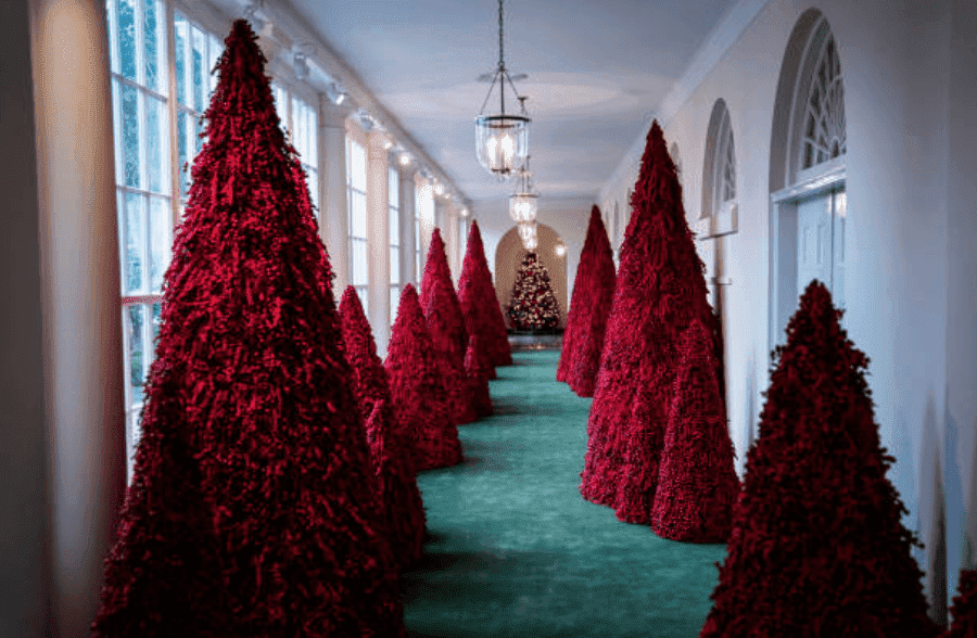Red Christmas trees chosen by Melania Trump for Christmas decorations line the East Colonnade of the White House, on Monday, Nov. 26, 2018, in Washington, DC | Source: Jabin Botsford/The Washington Post via Getty Images