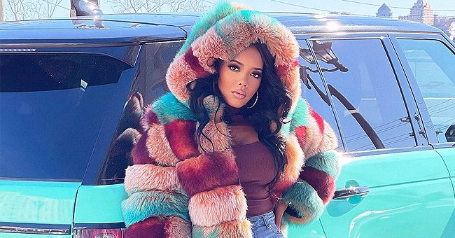 Angela Simmons Makes Hearts Go Wild Posing Next to a Blue Range Rover in Fur Coat & Brown Boots