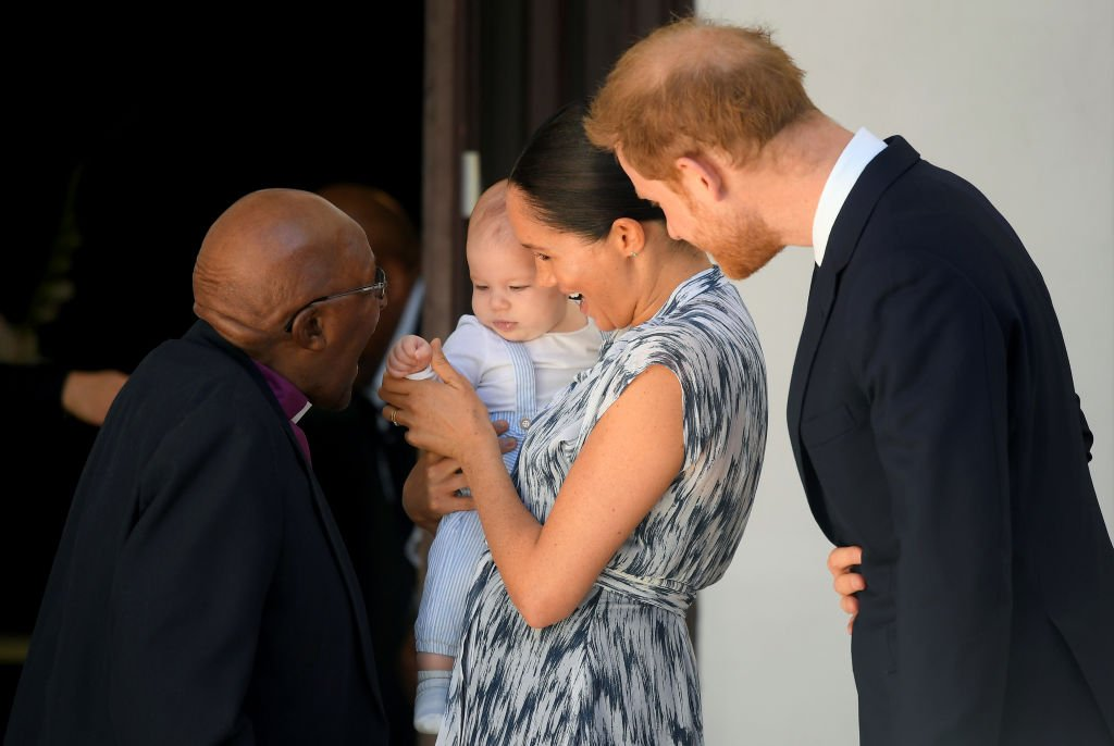 Prince Harry, Meghan, and their baby son Archie Mountbatten-Windsor meet Archbishop Desmond Tutu and his daughter Thandeka Tutu-Gxashe at the Desmond & Leah Tutu Legacy Foundation. | Source: Getty Images