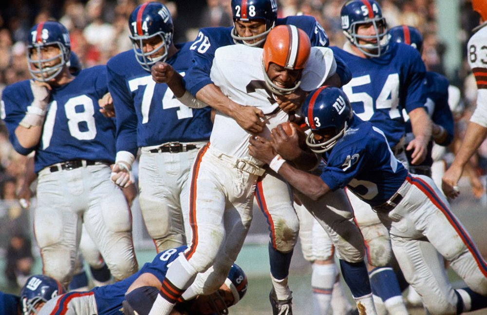 Cleveland Browns' Jim Brown (32) in action, rushing vs the New York Giants at Yankee Stadium. Bronx, NY 10/24/1965. I Image: Getty Images.