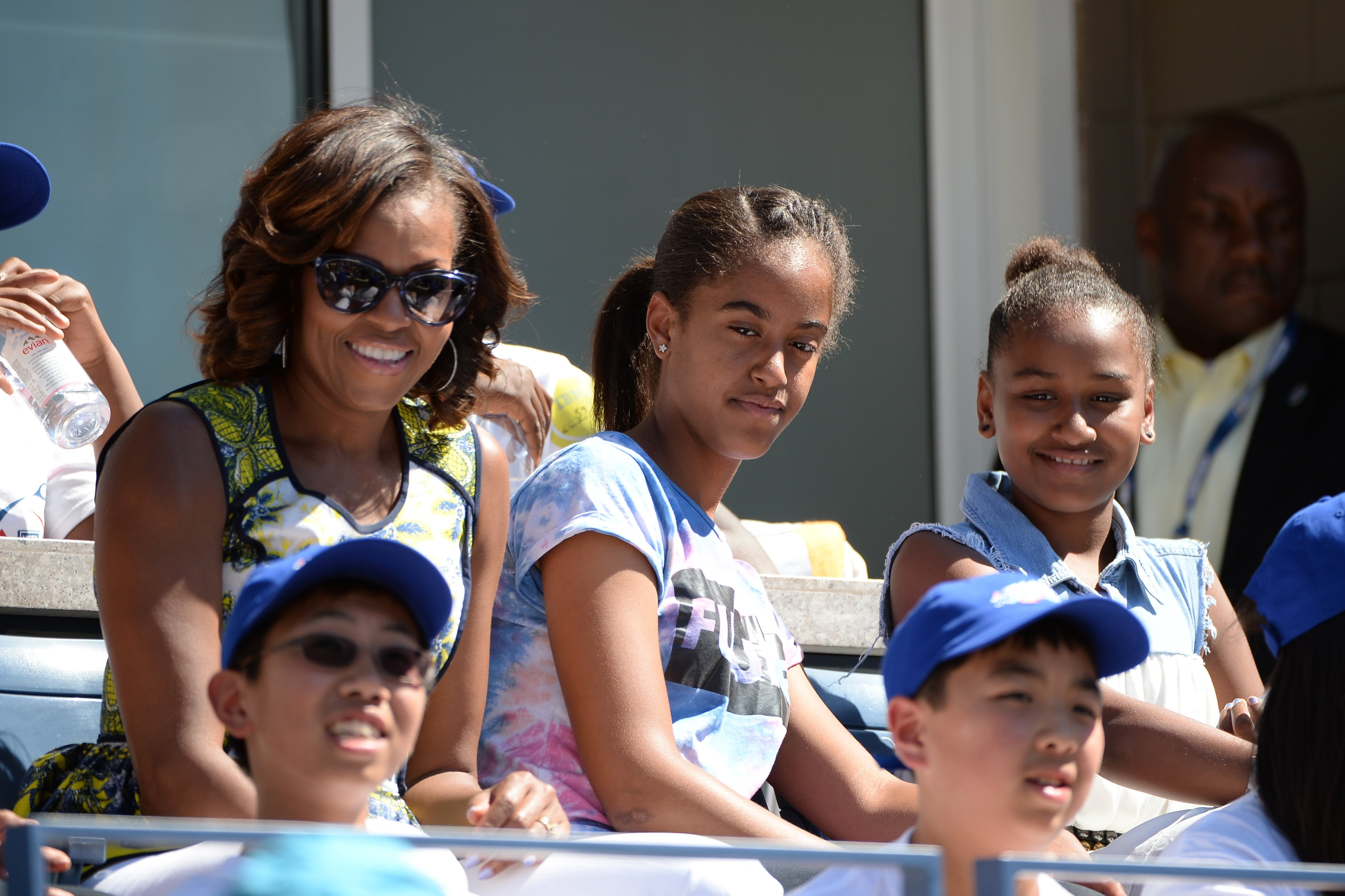 Michelle Obama & daughters Sasha and Malia at the Arthur Ashe Kids Day on Aug. 24, 2013 in New York City | Photo: Getty Images