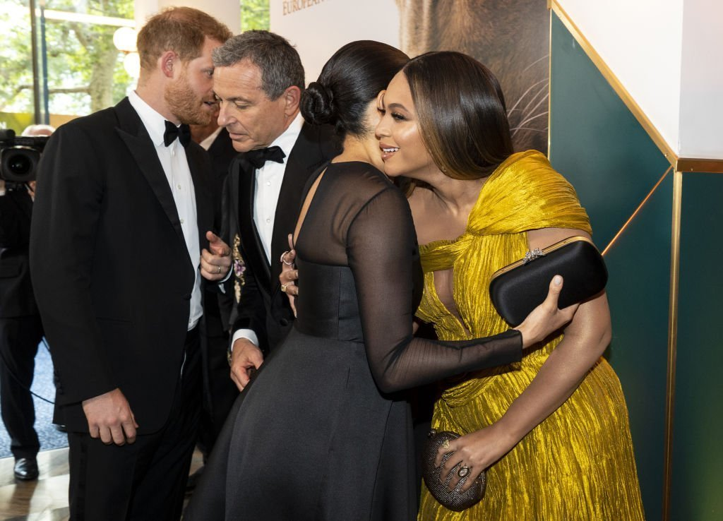 "Prince Harry, Duke of Sussex and Meghan, Duchess of Sussex greet Disney CEO Robert Iger US singer-songwriter Beyoncé at the European Premiere of Disney's ""The Lion King"" at Odeon Luxe Leicester Square. 