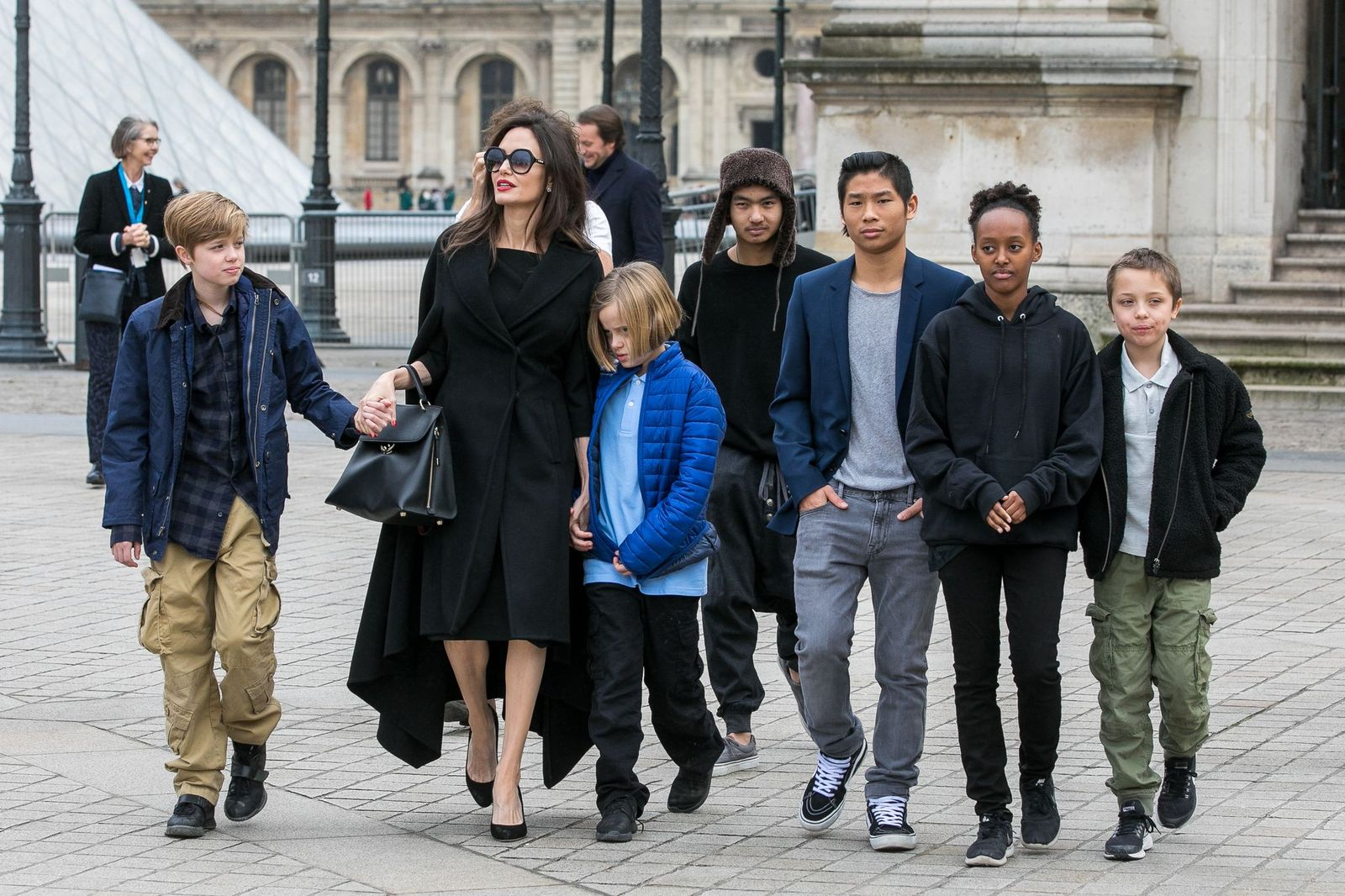 Angelina Jolie and her children Maddox, Shiloh, Vivienne, Knox, Zahara, and Pax Jolie-Pitt leaving the Louvre museum on January 30, 2018, in Paris, France | Photo: Marc Piasecki/GC Images/Getty Images