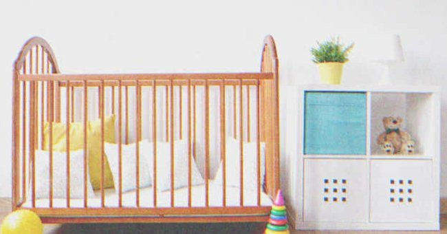 A baby crib in a room.   Source: Shutterstock