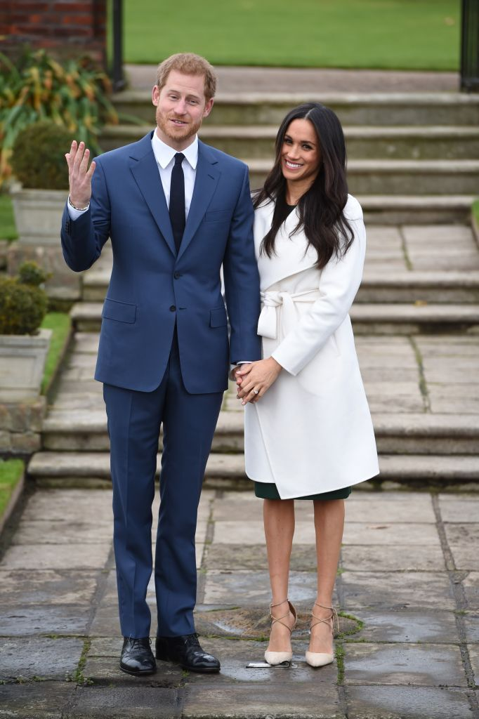 Prince Harry and actress Meghan Markle during an official photocall to announce their engagement at The Sunken Gardens at Kensington Palace | Photo: Getty Images