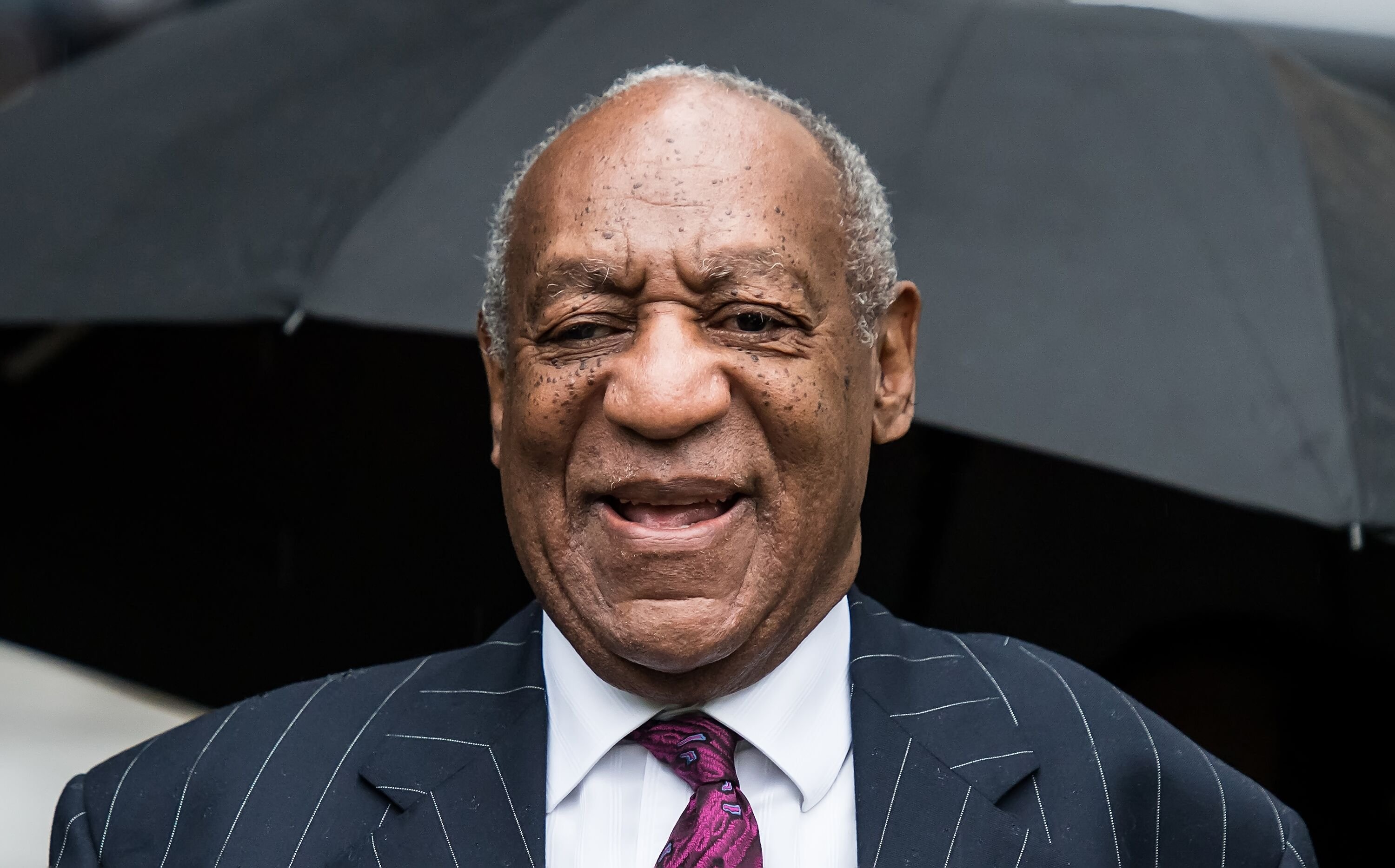 Bill Cosby exiting the courtroom during the Andrea Constand trial/ Source: Getty Images/ Getty Images