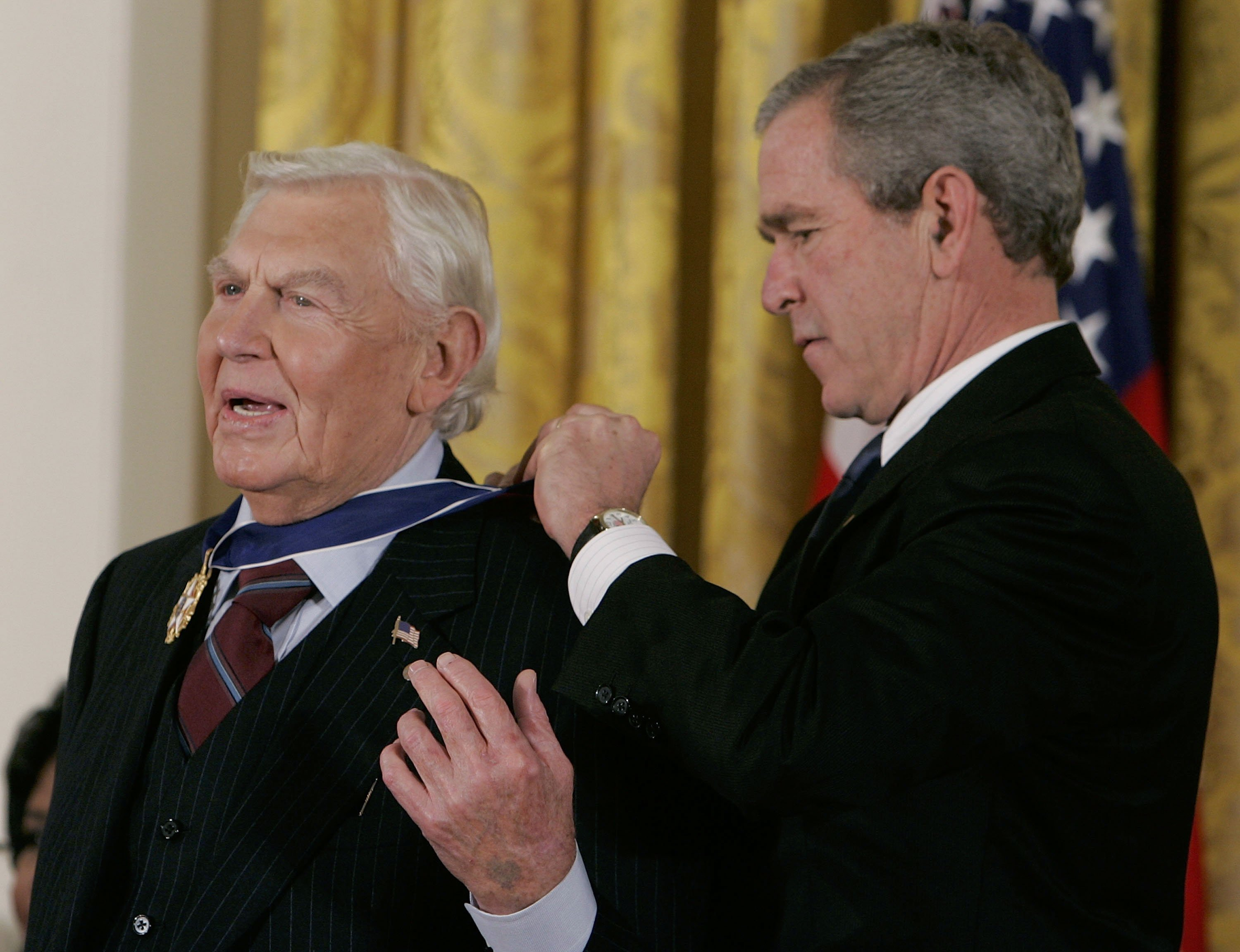Andy Griffith recieves the Medal of Freedom from U.S. President George W. Bush during a ceremony at the White House in 2005. Image credit: Getty Images/GlobalImagesUkraine