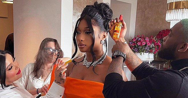 Megan Thee Stallion Stuns at the Grammys in an Orange Dress with a Slit & Huge Bow at the Back
