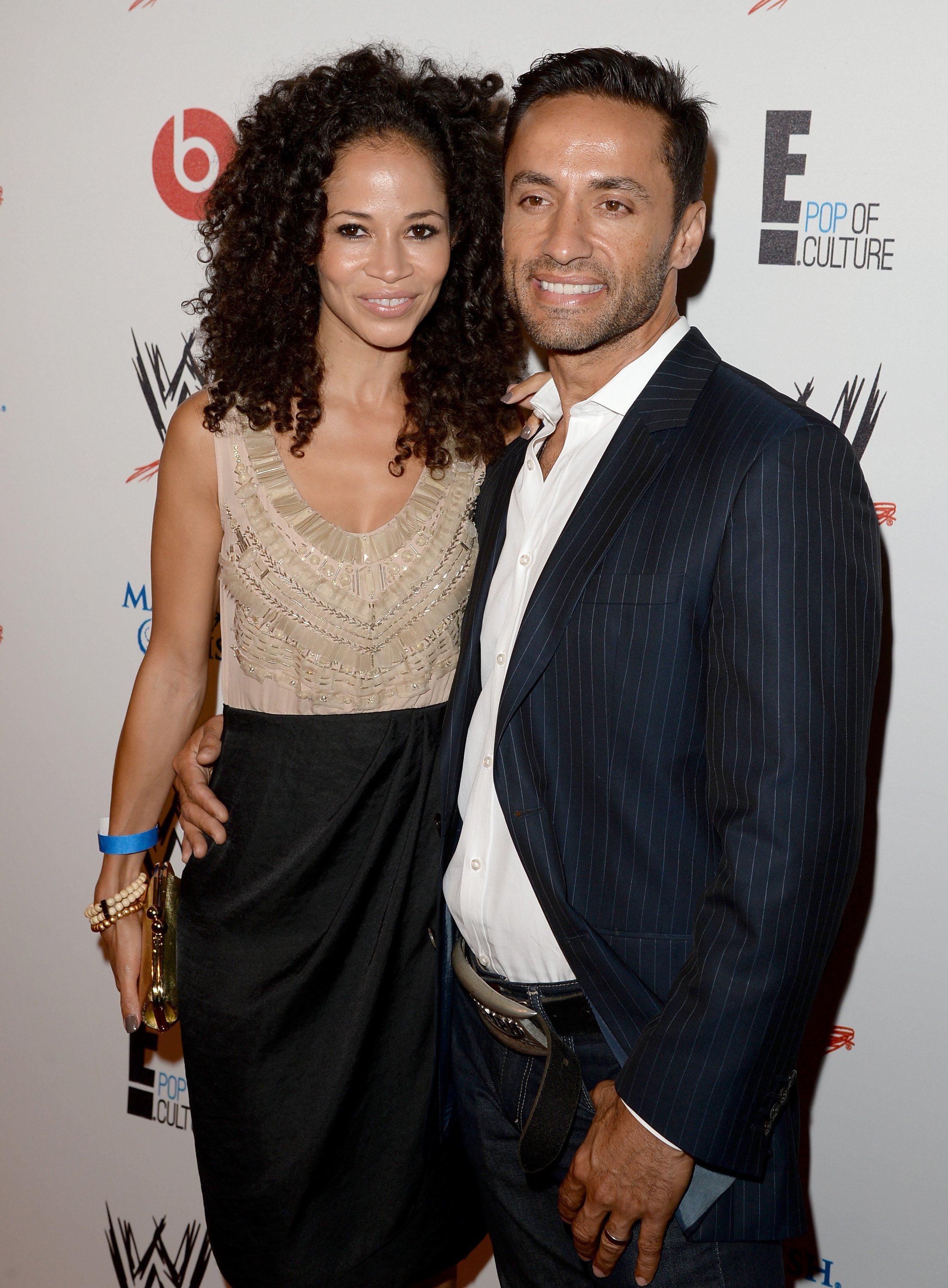 "Sherri Saum (L) and Kamar de los Reyes attends WWE & E! Entertainment's ""SuperStars For Hope"" at the Beverly Hills Hotel on August 15, 2013, in Beverly Hills, California. 