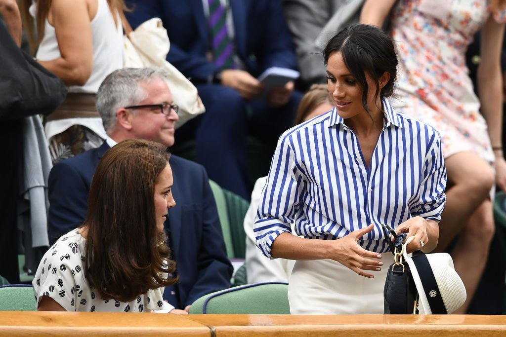 Kate Middleton and Meghan Markle attend day twelve of the Wimbledon Lawn Tennis Championships at All England Lawn Tennis and Croquet Club | Photo: Getty Images