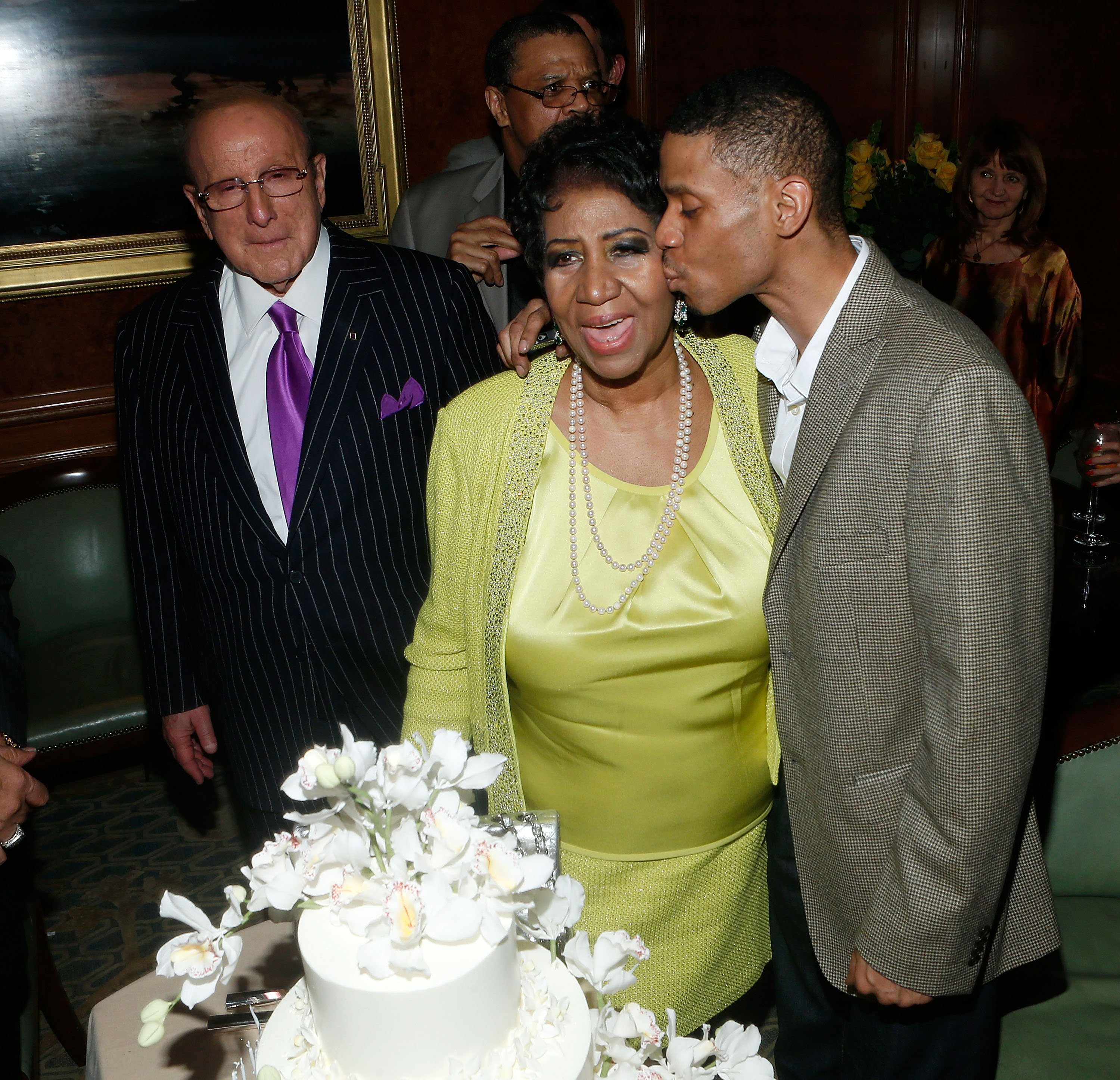 (L-R) Clive Davis, Aretha Franklin & Kecalf Franklin at her Birthday Celebration in New York City on March 22, 2014 | Photo: Getty Images