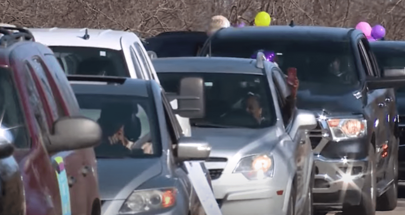 People drive during a birthday parade for 103-year-old woman Della Hathorne who beat COVID-19 on January 30, 20201. | Source: YouTube/KOCO5News