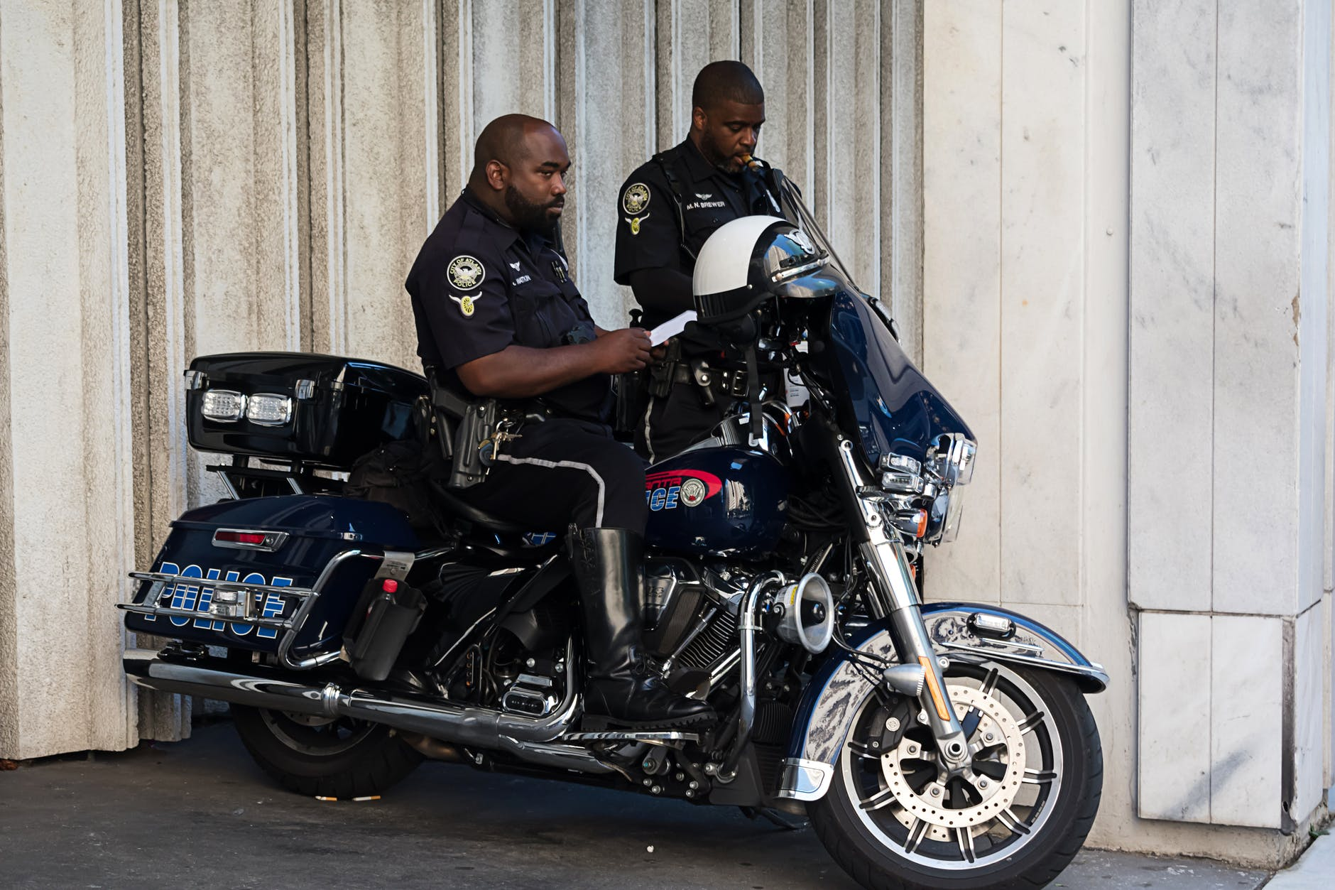 Two police officers on their motorcycle   Source: Pexels