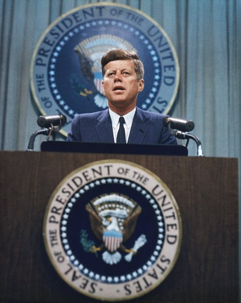 President John F. Kennedy addressed a press conference, circa 1963. | Photo: Getty Images
