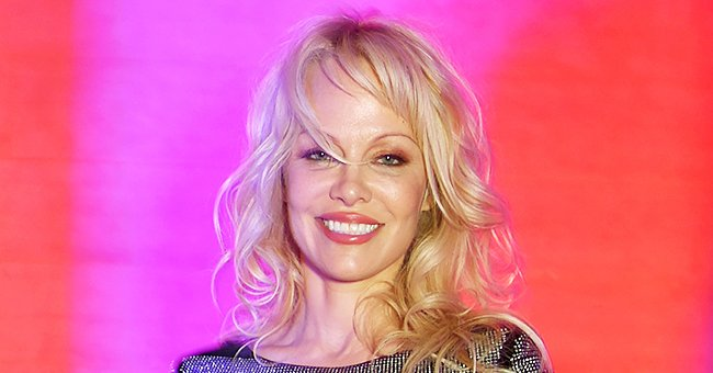 Pamela Anderson Shows off Her Stunning Figure as She Poses in a Swimsuit (Photo)
