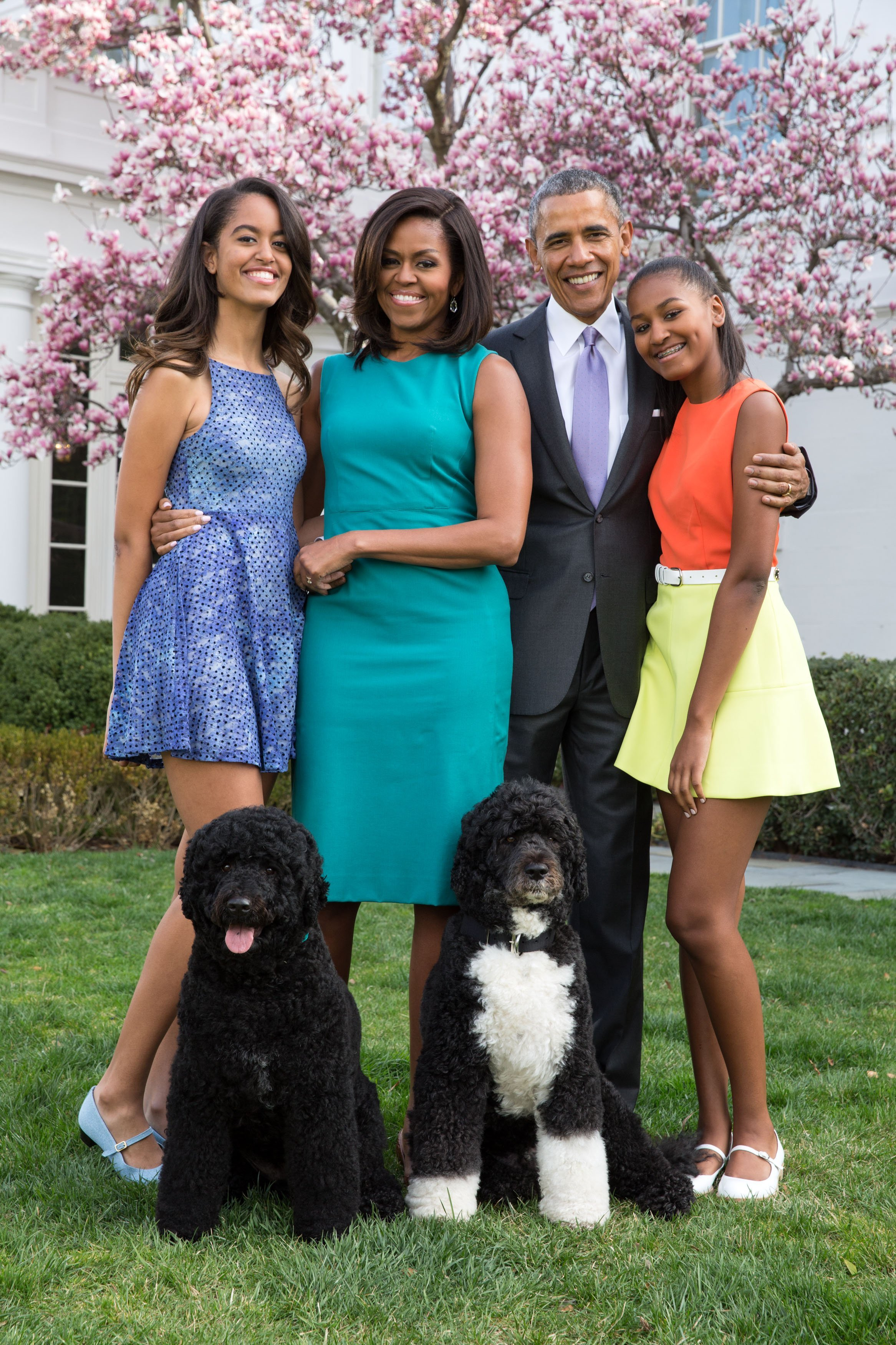 President Barack Obama, First Lady Michelle Obama, and daughters Malia (L) and Sasha (R) with their pets in the Rose Garden of the White House on Easter Sunday, April 5, 2015, in Washington, DC.