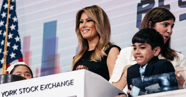 First Lady Melania Trump Visits NYSE in Sleeveless Black Prada Dress and Fans Praise Her Style