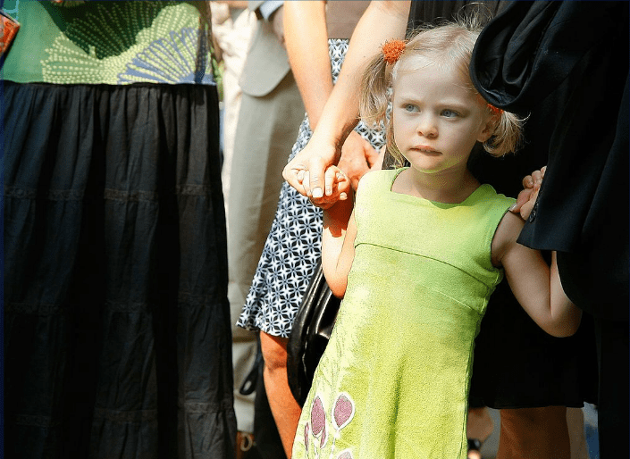 Seven year-old Sophie Ostroy, daughter of Adrienne Shelly listens as her father Andy Ostry speaks at the Adrienne Shelly Memorial Garden dedication ceremony at Abingdon Square Park on August 3, 2009 in New York City.  Source: Getty Images