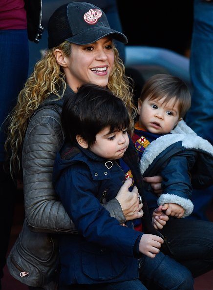 Shakira carries her children Milan and Sasha ahead of the La Liga match between FC Barcelona and Real Sociedad de Futbol at Camp Nou on November 28, 2015, in Barcelona, Spain. | Source: Getty Images.
