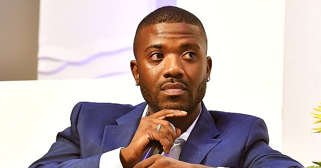 Ray J's Son Epik Looks Serious Sitting on His Mom's Arm While Doing Baby Talk Into Camera