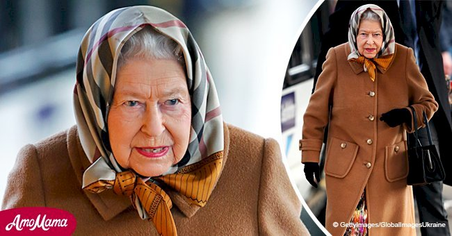 Queen travels by public train wearing a cozy headscarf at the start of her Christmas holidays