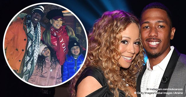 Nick Cannon poses with Mariah Carey and their twins Monroe and Moroccan on Christmas Eve