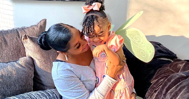 Toya Wright & 2-Year-Old Daughter Reign Watch Cartoon Together Wearing Hair Bonnets