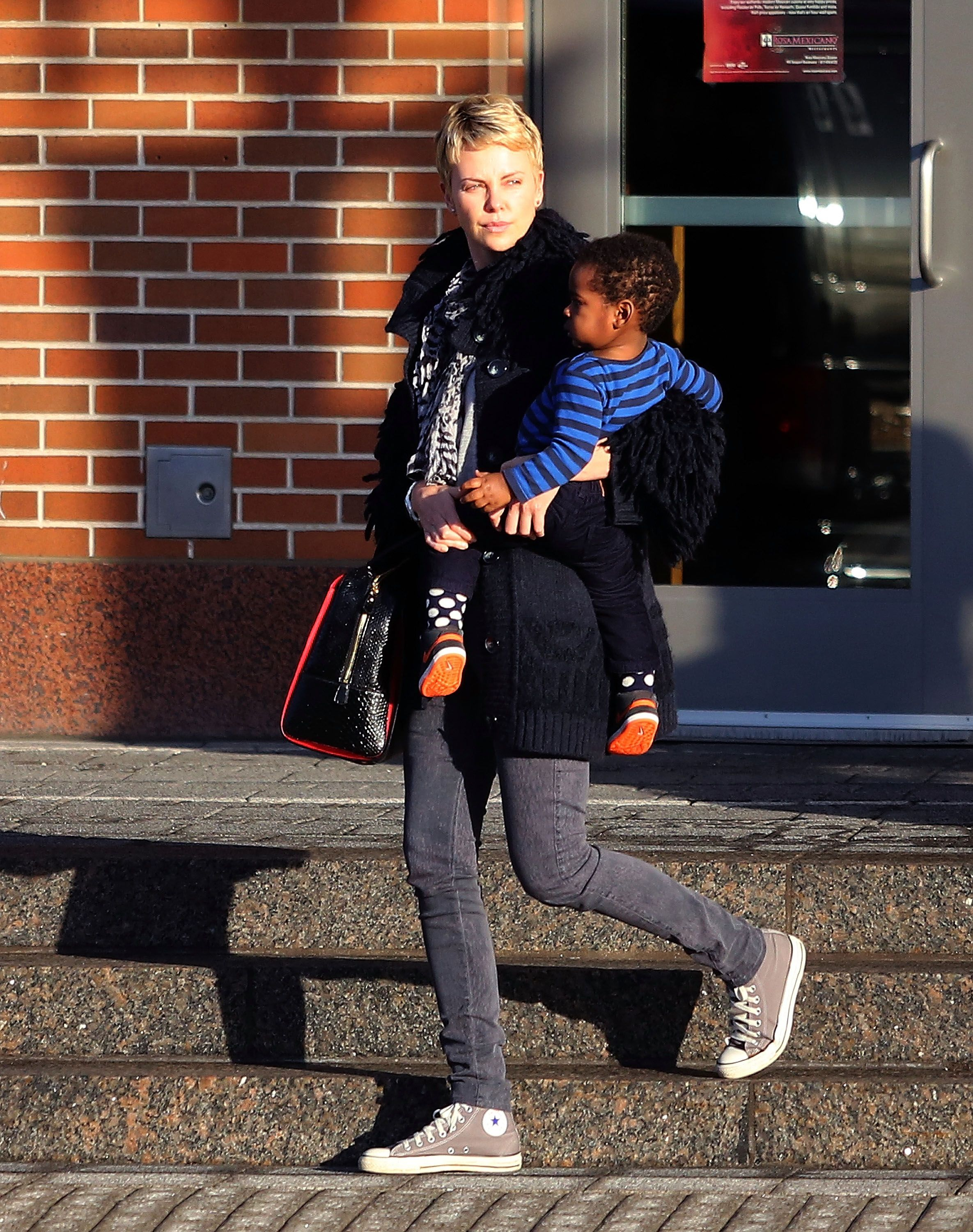 Charlize Theron with Jackson Theron on March 24, 2013, in Boston, Massachusetts | Photo: Stickman/Bauer-Griffin/GC Images