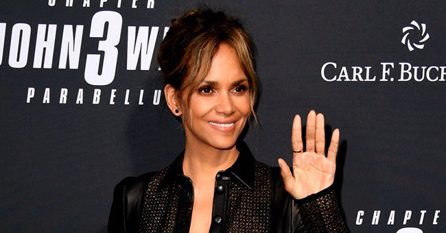 Check Out Halle Berry with Her Curves on Display in White Silk Dress with a Deep Slit (Photo)