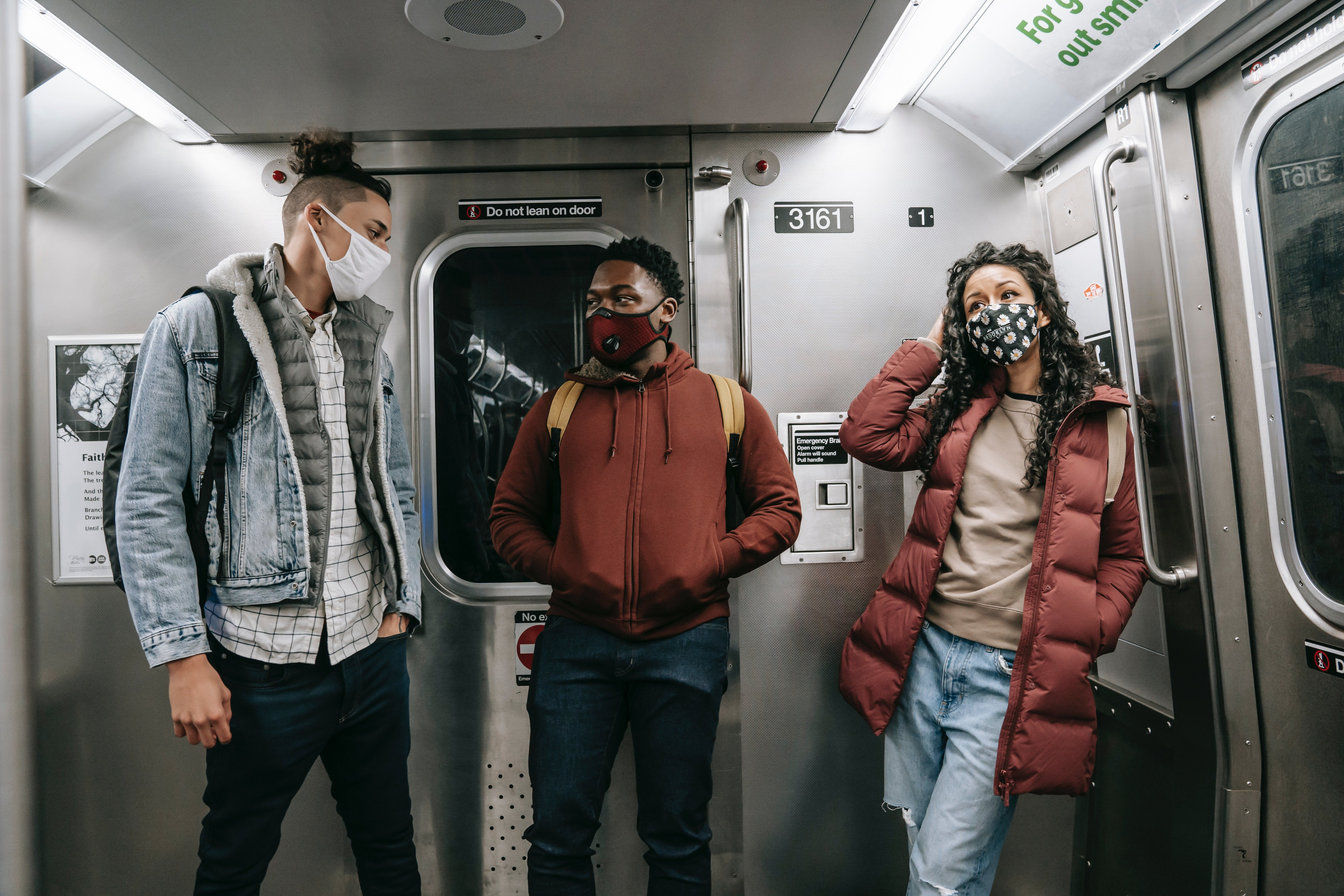 Pictured - Three friends wearing masks on a subway train | Source: Pexels